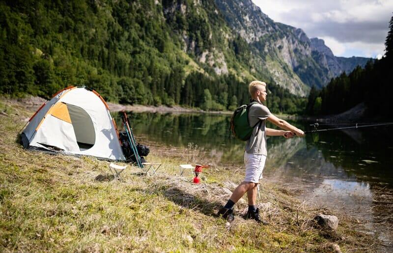 Man fishing when camping